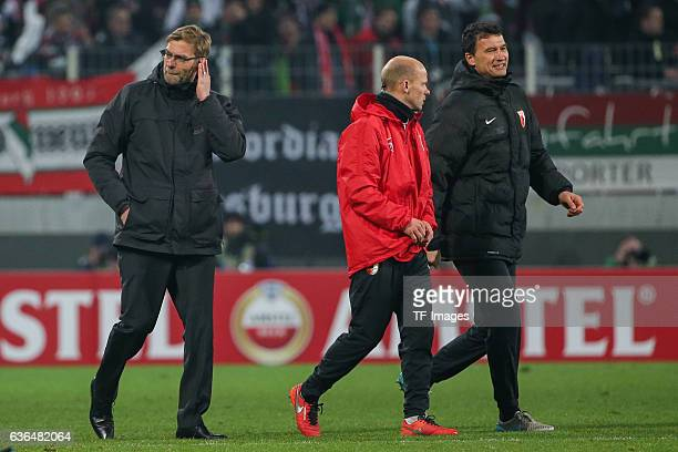 Coach Juergen Klopp of FC Liverpool Tobias Werner of FC Augsburg and Keeper Coach Zdenko Miletic of FC Augsburg looks on during the UEFA Europa...