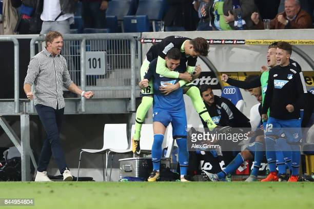 Coach Julian Nagelsmann of Hoffenheim and players and staff from the bench celebrate after the Bundesliga match between TSG 1899 Hoffenheim and FC...