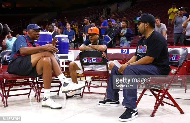 Coach Julius 'Dr J' Erving of TriState Allen Iverson of 3's Company and founder Ice Cube speak during week four of the BIG3 three on three basketball...