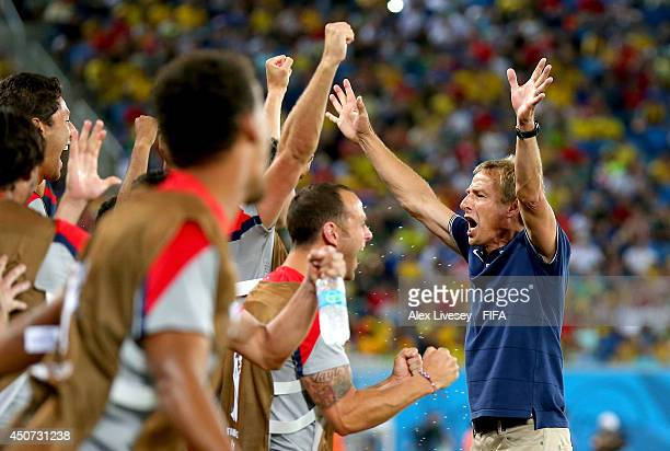 Coach Jurgen Klinsmann of the United States celebrates after the 2014 FIFA World Cup Brazil Group G match between Ghana and USA at Estadio das Dunas...