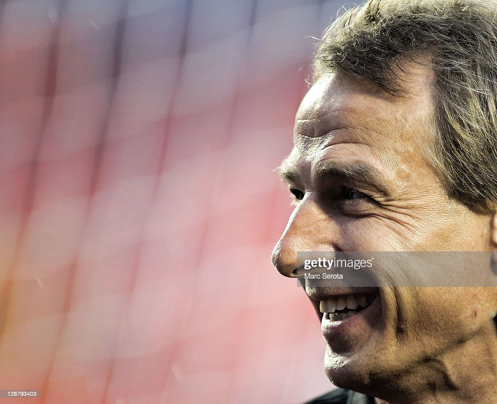 Coach Jurgen Klinsmann of the USA smiles against Honduras at Sun Life Stadium on October 8, 2011 in Miami Gardens, Florida.