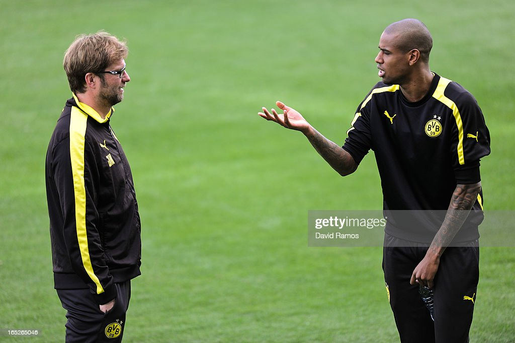Coach Jurgen Klopp (L) of Borussia Dortmund chats with <a gi-track='captionPersonalityLinkClicked' href=/galleries/search?phrase=Felipe+Santana&family=editorial&specificpeople=5422021 ng-click='$event.stopPropagation()'>Felipe Santana</a> during training session ahead of the UEFA Champions League quarter-final first leg match against Malaga CF, at La Rosaleda Stadium on April 2, 2013 in Malaga, Spain.