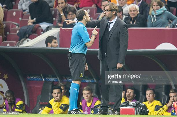 coach Jurgen Klopp of Borussia Dortmund in discussion with referee Mateu Lahoz during the UEFA Champions League group D match between Galatasaray and...