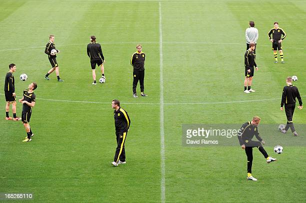 Coach Jurgen Klopp of Borussia Dortmund looks at his players during training session ahead of the UEFA Champions League quarterfinal first leg match...