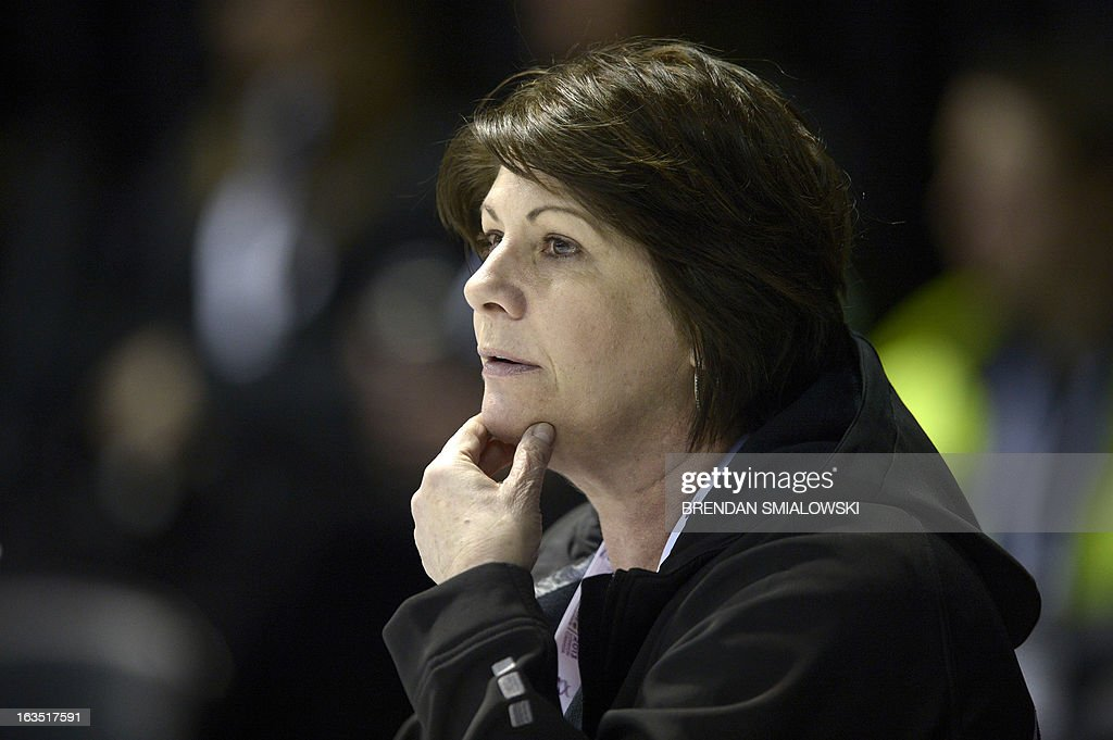 Coach Kathy Johnson watches as Patrick Chan competing for Canada a he practices at Budweiser Gardens in preparation for the 2013 World Figure Skating Championships in London, Ontario, Canada, March 11, 2013. Skaters from around the globe are preparing for the competition which starts on Wednesday. AFP PHOTO/Brendan SMIALOWSKI
