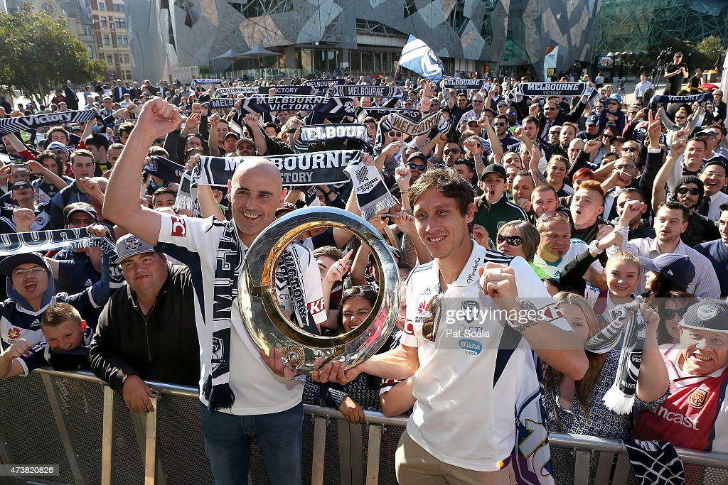 Coach Kevin Muscat and Captain Mark Milligan with the ALeague trophy during the Melbourne Victory ALeague Grand Final Celebrations at Federation...