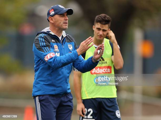 Coach Kevin Muscat gives instructions during a Melbourne Victory ALeague training session at Gosch's Paddock on March 28 2014 in Melbourne Australia