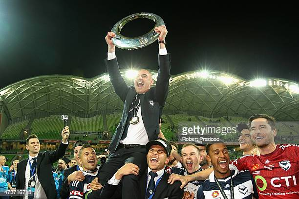 Coach Kevin Muscat of Melbourne celebrates with players after a win during the 2015 ALeague Grand Final match between the Melbourne Victory and...
