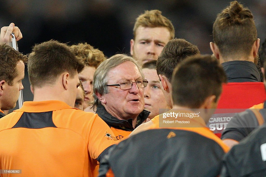 Coach Kevin sheedy of the Giants speaks to his players during the round 18 AFL match between the Collingwood Magpies and the Greater Western Sydney Giants at Melbourne Cricket Ground on July 27, 2013 in Melbourne, Australia.
