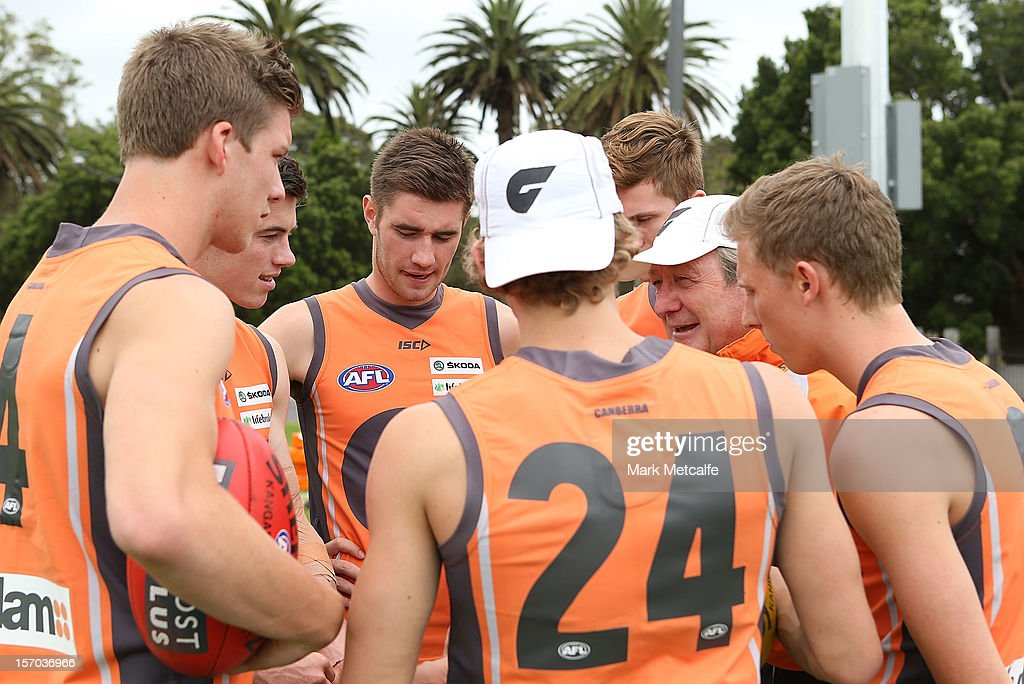 Coach Kevin Sheedy talks with new draft players Aidan Corr, Christian Jaksch, Jonathan O'Rouke, Lachie Whitfield, Lachie Plowman and James Stewart during a Greater Western Sydney Giants AFL pre-season training session at Lakeside Oval on November 28, 2012 in Sydney, Australia.