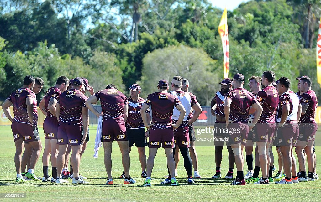 Coach Kevin Walters chats with his players during a Queensland Maroons State of Origin training session on May 29, 2016 in Gold Coast, Australia.