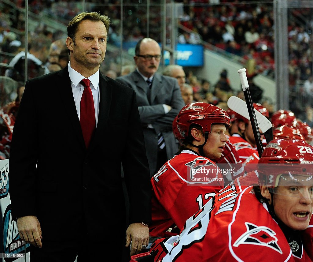 Coach Kirk Mueller of the Carolina Hurricanes watches his team during a game against the Ottowa Senators during play at PNC Arena on February 1, 2013 in Raleigh, North Carolina. The Hurricanes defeated the Senators, 1-0.