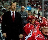 Coach Kirk Mueller of the Carolina Hurricanes watches his team during a game against the Ottowa Senators during play at PNC Arena on February 1 2013...