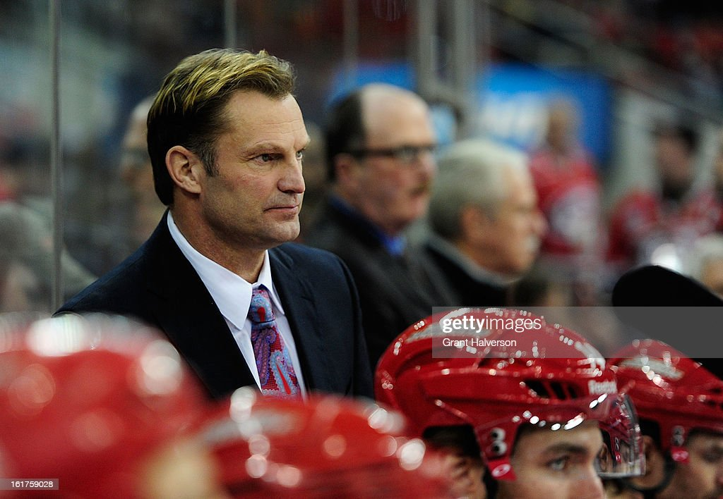 Coach Kirk Mueller of the Carolina Hurricanes watches his team during a win over the Toronto Maple Leafs at PNC Arena on February 14, 2013 in Raleigh, North Carolina. Carolina defeated Toronto 3-1.
