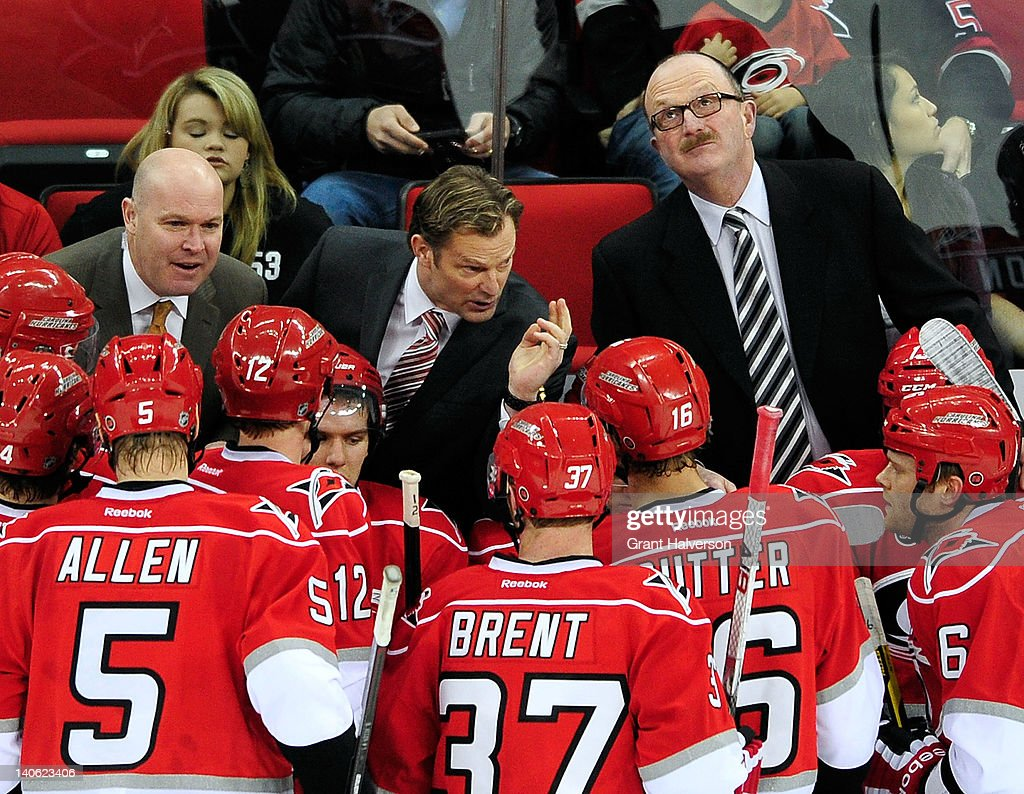 Coach Kirk Muller of the Carolina Hurricanes huddles with his team during the closing seconds of a win over the Nashville Predators during play at the RBC Center on February 28, 2012 in Raleigh, North Carolina. The Hurricanes won 4-3.