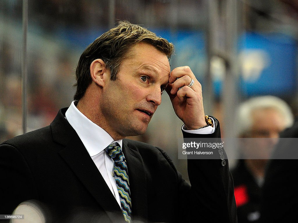 Coach Kirk Muller of the Carolina Hurricanes watches his team against the Buffalo Sabres during play at the RBC Center on January 6, 2012 in Raleigh, North Carolina. The Hurricanes won 4-2.