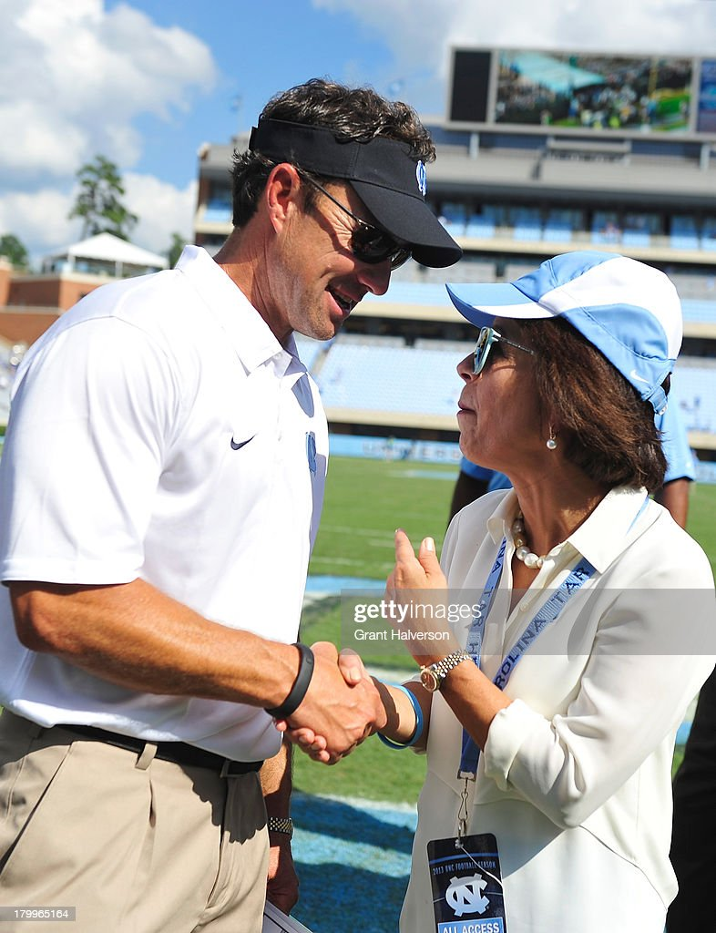 Coach Larry Fedora of the North Carolina Tar Heels shakes hands with Chancellor Carol Folt after a win over the Middle Tennessee State Blue Raiders at Kenan Stadium on September 7, 2013 in Chapel Hill, North Carolina. North Carolina won 40-20.