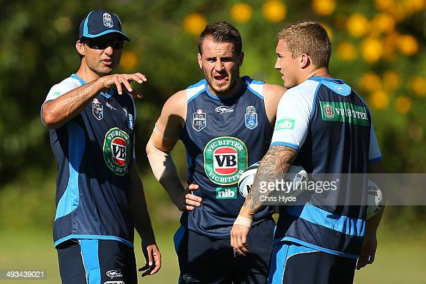 Coach Laurie Daley talks to Josh Reynolds and Trent Hodkinson during a New South Wales Blues State of Origin training session on May 24 2014 in Coffs...