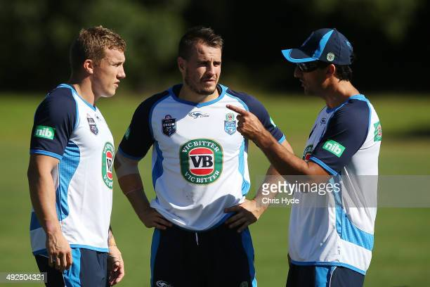 Coach Laurie Daley talks to Trent Hodkinson and Josh Reynolds during a New South Wales Blues State of Origin training session at Novotel Coffs...