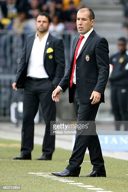 Coach Leonardo Jardim of AS Monaco and Coach Uli Forte of BSC Young Boys look on during the UEFA Champions League third qualifying round 1st leg...