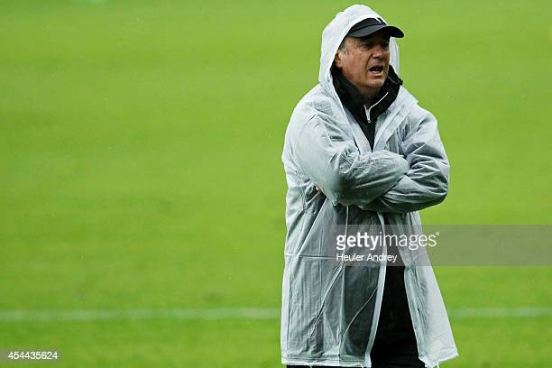 Coach Levir Culpi of AtleticoMG during the match between Coritiba and AtleticoMG for the Brazilian Series A 2014 at Couto Pereira stadium on August...