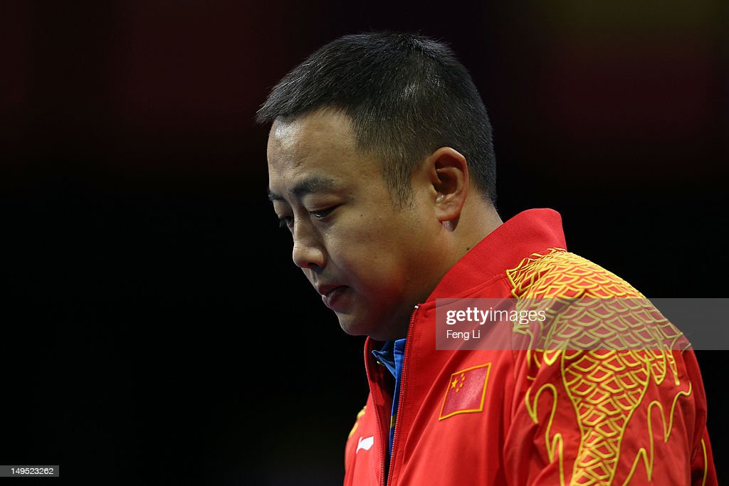 Coach <a gi-track='captionPersonalityLinkClicked' href=/galleries/search?phrase=Liu+Guoliang&family=editorial&specificpeople=655363 ng-click='$event.stopPropagation()'>Liu Guoliang</a> of China watches Zhang Jike of China during his Men's Singles Table Tennis third round match against Bora Vang of Turkey on Day 3 of the London 2012 Olympic Games at ExCeL on July 30, 2012 in London, England.