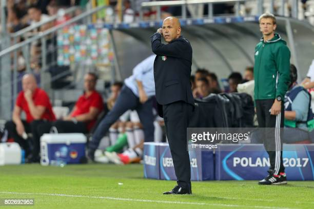 coach Luigi Di Biagio of Italy looks on during the UEFA U21 championship match between Italy and Germany at Krakow Stadium on June 24 2017 in Krakow...