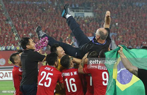 Coach Luiz Felipe Scolari of Guangzhou Evergrande throwed by the players of Guangzhou Evergrande after winning the Asian Champions League Final 2nd...