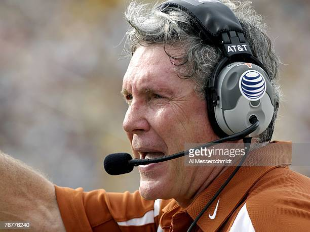 Coach Mack Brown of the Texas Longhorns watches play against the University of Central Florida Knights at Bright House Networks Stadium on September...