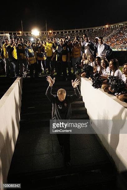 Coach Mano Menezes leaves the field as he is acclaimed by supporters after the soccer match between Corinthians v Guarani as part of the Serie A at...