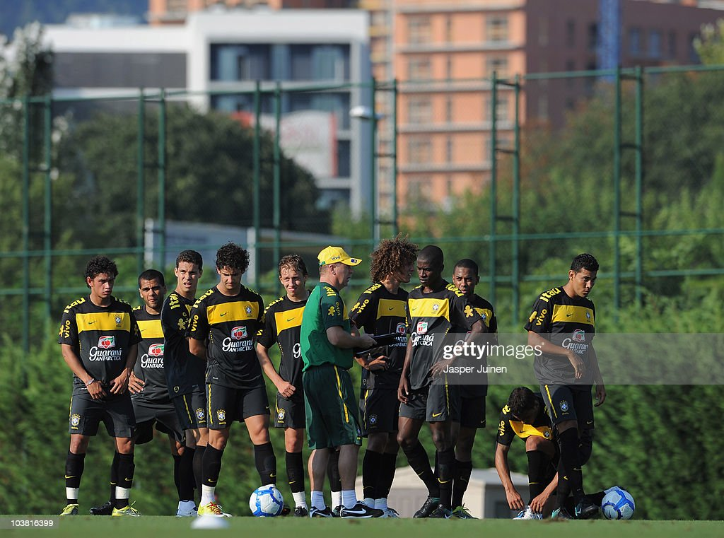 Coach Mano Menezes (C) of Brazil stands amid his players during a training session at the Joan Gamper training ground on September 3, 2010 in Barcelona, Spain.