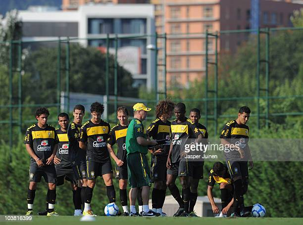 Coach Mano Menezes of Brazil stands amid his players during a training session at the Joan Gamper training ground on September 3 2010 in Barcelona...