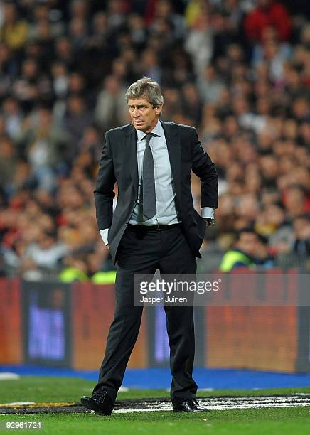 Coach Manuel Pellegrini of Real Madrid follows his players during the Copa del Rey fourth round second leg match between Real Madrid and AD Alcorcon...