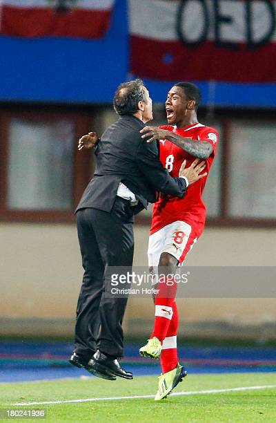 Coach Marcel Koller and David Alaba of Austria celebrate after scoring during the FIFA World Cup 2014 Group C qualification match between Austria and...