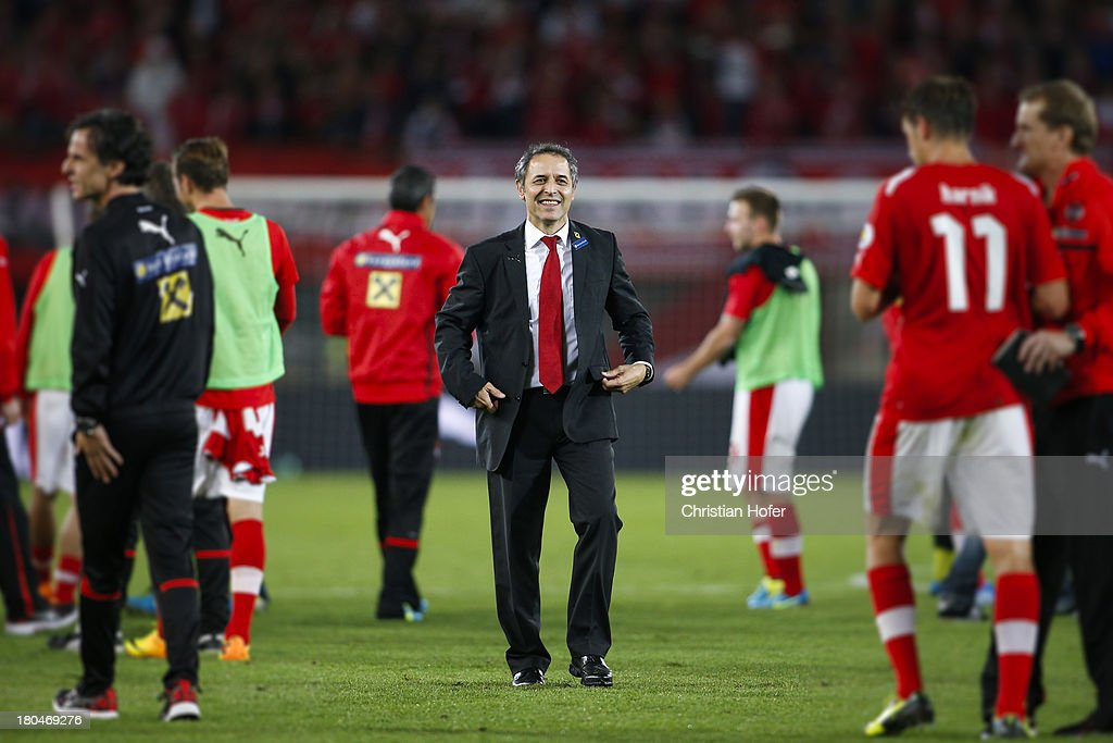 Coach <a gi-track='captionPersonalityLinkClicked' href=/galleries/search?phrase=Marcel+Koller&family=editorial&specificpeople=535663 ng-click='$event.stopPropagation()'>Marcel Koller</a> of Austria smiles after winning the FIFA World Cup 2014 Group C qualification match between Austria and the Republic of Ireland at the Ernst Happel Stadium on September 10, 2013 in Vienna, Austria.