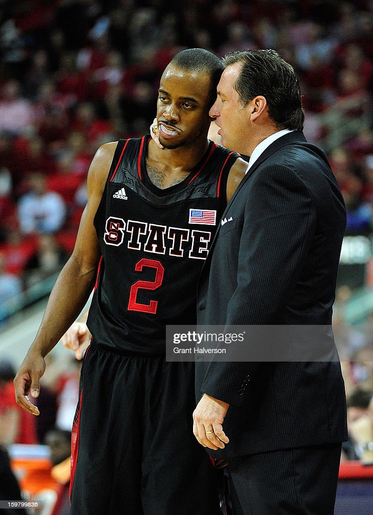 Coach Mark Gottfried confers with Lorenzo Brown #2 of the North Carolina State Wolfpack during the finalseconds of a win over the Clemson Tigers at PNC Arena on January 20, 2013 in Raleigh, North Carolina. North Carolina State won 66-62.