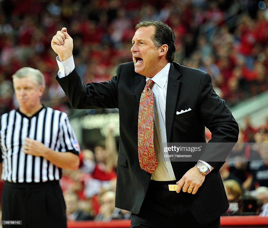 Coach Mark Gottfried of the North Carolina State Wolfpack lobbies the officials to count the basket after a foul by the Clemson Tigers during play at PNC Arena on January 20, 2013 in Raleigh, North Carolina. North Carolina State won 66-62.