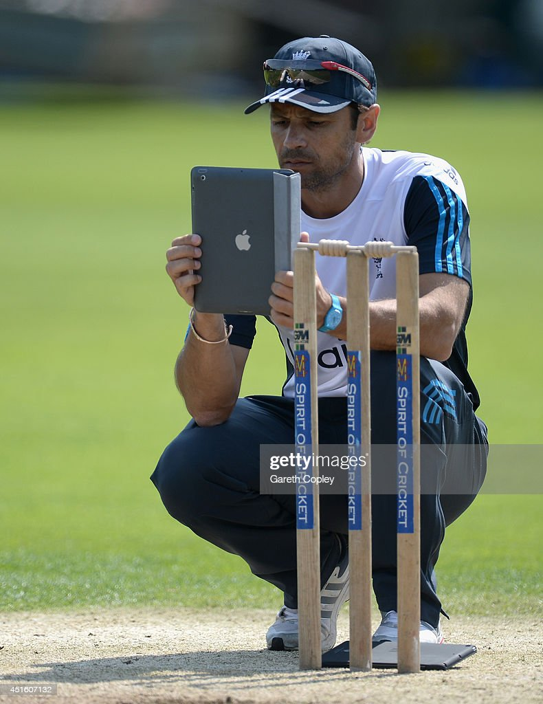 ECB coach <a gi-track='captionPersonalityLinkClicked' href=/galleries/search?phrase=Mark+Ramprakash&family=editorial&specificpeople=240276 ng-click='$event.stopPropagation()'>Mark Ramprakash</a> films on a iPad during a training session at the ECB National Cricket Performance Centre on July 2, 2014 in Loughborough, England.