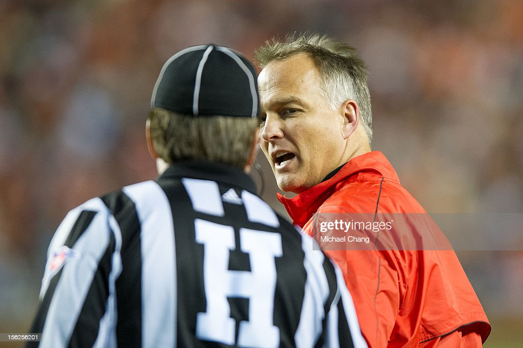 Coach Mark Richt of the Georgia Bulldogs speaks to an official during their game against the Auburn Tigers on November 10, 2012 at Jordan-Hare Stadium in Auburn, Alabama. Georgia defeated Auburn 38-0 and clinched the SEC East division.