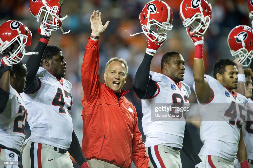 Coach Mark Richt of the Georgia Bulldogs warms up with his team before their game against the Auburn Tigers on November 10, 2012 at Jordan-Hare Stadium in Auburn, Alabama. Georgia defeated Auburn 38-0 and clinched the SEC East division.