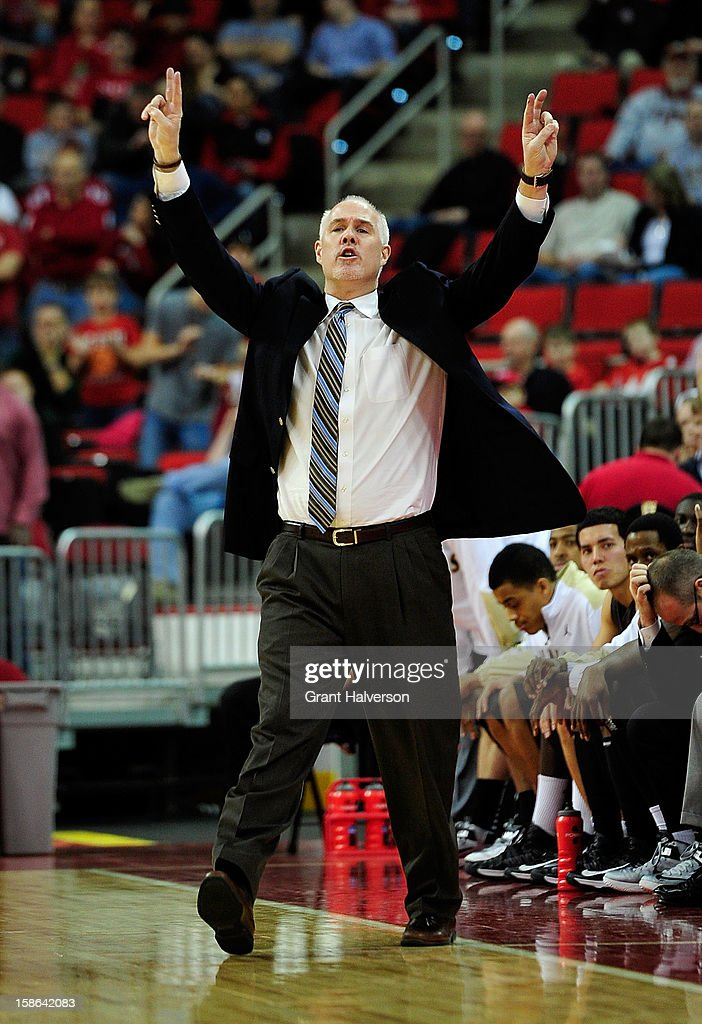 Coach Mark Schmidt of the St. Bonaventure Bonnies directs his team during a game against the North Carolina State Wolfpack at PNC Arena on December 22, 2012 in Raleigh, North Carolina.