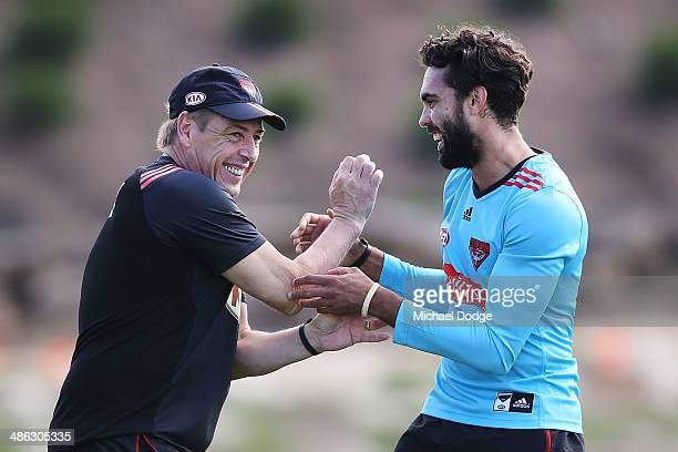 Coach Mark Thompson reacts to Courtenay Dempsey during an Essendon Bombers AFL training session at True Value Solar Centre on April 24 2014 in...