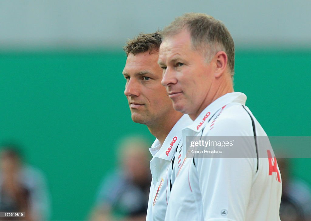 Coach Markus Weinzierl and manager Stefan Reuter of Augsburg during the DFBCup between RB Leipzig and FC Augsburg at Zentralstadion on August 02 2013...