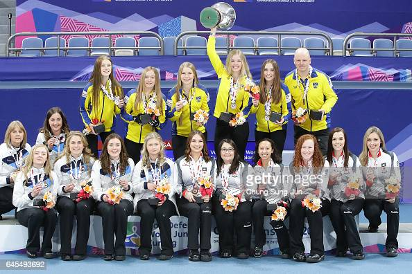 Coach Mathias Mabergs and gold medalists Maria Larsson Fanny Sjoeberg Almida De Val Jennie Waahlin and Isabella Wranaa of Sweden coach Cate Brewster...