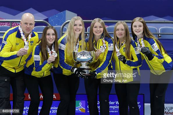 Coach Mathias Mabergs and gold medalists Maria Larsson Fanny Sjoeberg Almida De Val Jennie Waahlin and Isabella Wranaa of Sweden celebrate in the...