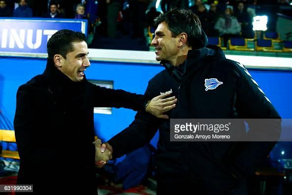 Coach Mauricio Pellegrino of Deportivo Alaves clashes hands with coach Julio Velazquez of Agrupacion Deportivo Alcorcon during the Copa del Rey...