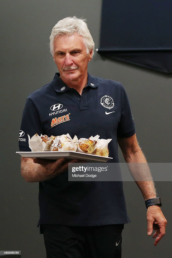 Coach Michael Malthouse brings in muffins for the media during a Carlton Blues media session at Visy Park on March 26, 2014 in Melbourne, Australia. Malthouse last week censured a photographer for eating a muffin during the media session.