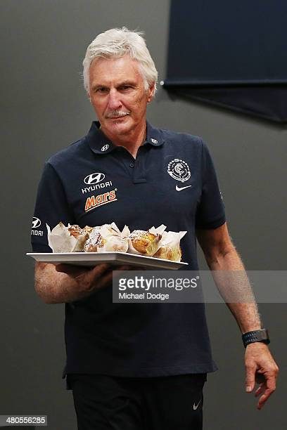 Coach Michael Malthouse brings in muffins for the media during a Carlton Blues media session at Visy Park on March 26 2014 in Melbourne Australia...