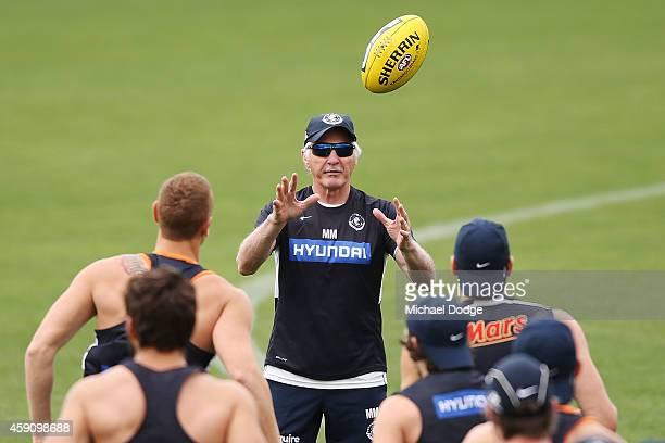 Coach Michael Malthouse marks the ball during a Carlton Blues AFL preseason training session at Visy Park on November 17 2014 in Melbourne Australia