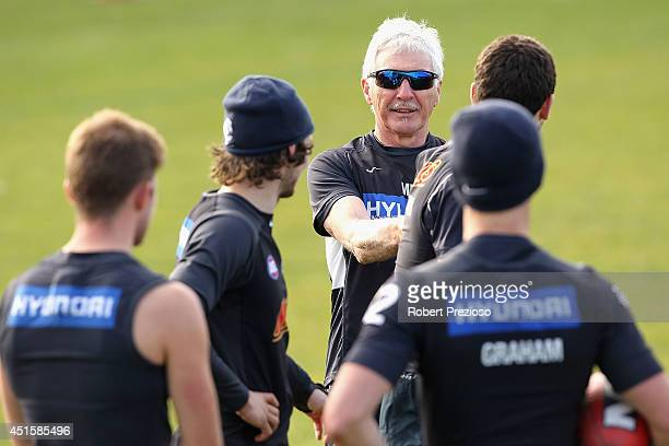 Coach Michael Malthouse speaks to players during a Carlton Blues AFL training session at Visy Park on July 2 2014 in Melbourne Australia